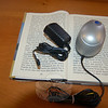 The portable magnifier MonoMouse is available at the C.H. Booth Library for low-vision readers during a trial period that runs through April 1. The product is easily connected to a home television to enlarge any text over which the computer mouse-style product is scrolled.	—Bee Photos, Crevier