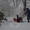 Main Street resident Don Elmer runs his snow blower along the sidewalk.  (Bobowick photo)