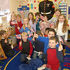 While Marine Corporal Daniel Williams was home from duty in Iraq and before leaving to help with relief work in Haiti in a few weeks, he stopped by Head O' Meadow school on Thursday, February 4, to visit students in Gail Diminico's kindergarten class.  (Hallabeck photo)