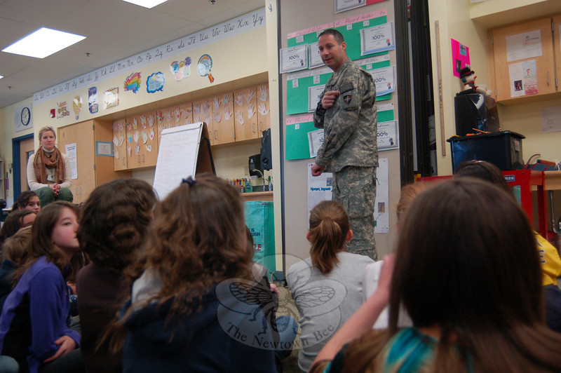 US Navy Captain Marc Mancher, the husband of Reed School sixth grade teacher Barbara Mancher, visited the school on Monday, February 1. He spoke to Ms Mancher's and Sara Strait's sixth grade cluster, who sent letters to his unit in Afghanistan through the St Valentine's Day Project this year. Captain Mancher's visit came during a two-week leave from duty.  (Hallabeck photo)