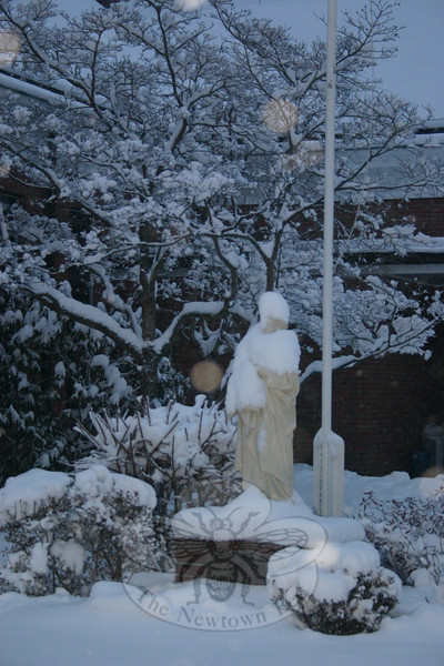 The statue of St Rose, outside the sanctuary on Church Hill Road that bears her name, was wearing a snow cap by late Tuesday afternoon.  (Hicks photo)