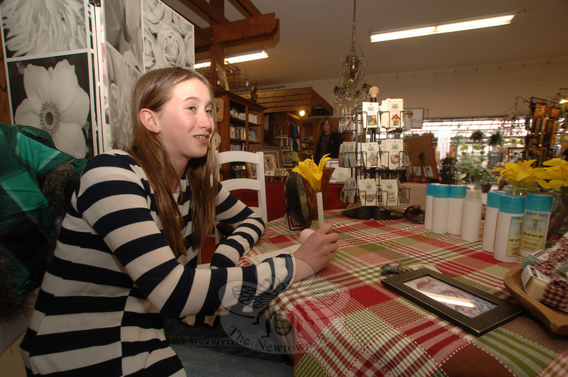 Megan Olszewski watched her mother Stacey's booth during last weekend's Escape The Winter Craft Show & Sale at Lexington Gardens.  (Bobowick photo)