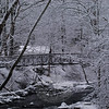 Chris Salvatore took the footbridge in Sandy Hook Center across the Pootatuck River and into a winter wonderland on Tuesday morning. The snowstorm that started overnight and continued throughout the day created beautiful scenery almost everywhere — except on the roads, where the traffic problems got pretty ugly as the day wore on.  (Clark photo)