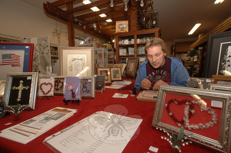 Basil Hanna of Basil's Quilling creates crafts including frames, keepsakes, and invitations with his art.  (Bobowick photo)