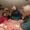 Cleo Conk serves Becky and Bob Virgalla during St John's Annual Shrove Tuesday Pancake Supper.  (Bobowick photo)