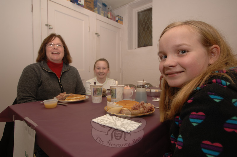 With their plates of pancakes and hash before them, Lisa Nowak and her daughters Melissa, beside her mother, and Kayla were ready to enjoy their Shrove Tuesday supper.  (Bobowick photo)