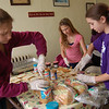 Girl Scout Troop 820 members, from left, Laurel Jones, Lauren Beier, and Marissa Chill worked to prepare peanut butter and jelly sandwiches for visitors to the Dorothy Day House in Danbury, to take with them after eating a dinner later at the hospitality house.  (Hallabeck photo)