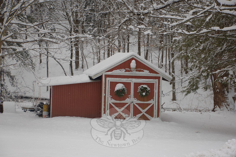 The Christmas wreaths that are still hanging on this shed on Berkshire Road looked even prettier with a fresh cap of snow Tuesday.  (Bobowick photo)