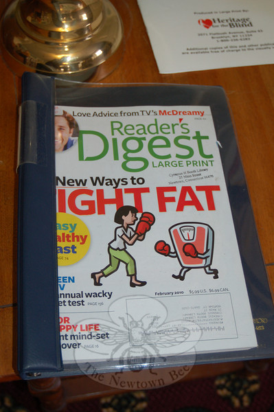 Readers' Digest magazine is part of the collection of large-print reading materials available for visually challenged patrons of the C.H. Booth Library.  (Crevier photo)