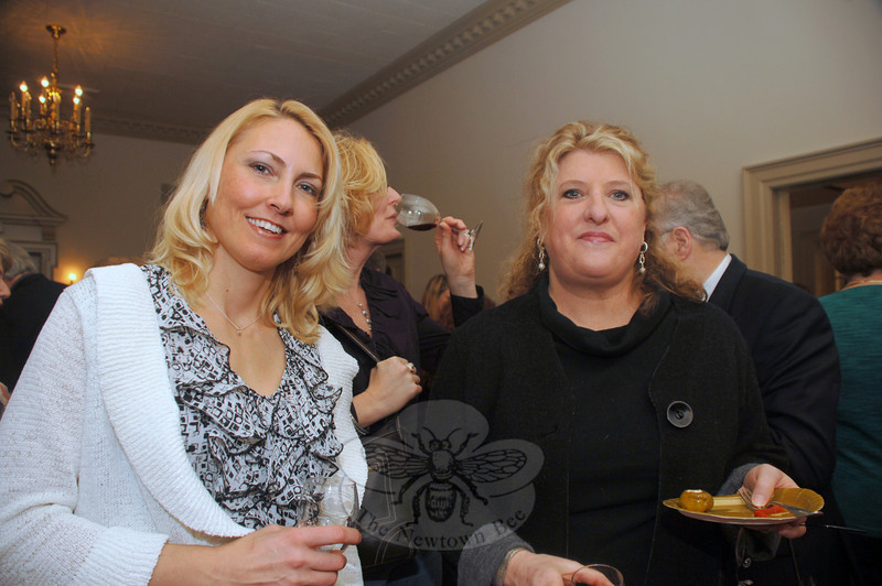 Tanja Gouveia, left shares a taste of wine with friends Nicole Skoda, background, and Ellen Adriani during the Mary Hawley Society's fundraiser to benefit the Edmond Town Hall.  (Bobowick photo)