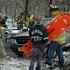 Dodgingtown volunteer firefighters and Newtown Volunteer Ambulance Corps members responded to a one-vehicle accident that occurred during slippery road conditions about 2:19 pm February 23 near 175 Hattertown Road. Police said motorist Helen Webb, 51, of Bethel, who was driving a 2000 Ford Explorer northward on Hattertown Road, skidded sideways into the driveway at 175 Hattertown Road and then struck a curbside mailbox and an embankment there. The SUV came to rest facing south alongside the street. Ambulance corps staffers transported Webb to Danbury Hospital to be checked for neck pain. Police issued Webb an infraction for driving an unregistered vehicle and also gave her a written warning for traveling unreasonably fast.  (Gorosko photo)