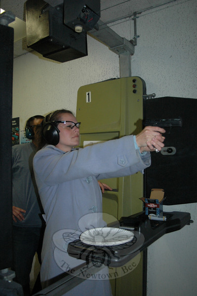 A registered nurse by day, Kent resident Faye Bouchard enjoys the clean and friendly atmosphere at Shooters along with her husband and regular, Chris. The New Milford range also hosts popular weekly mixed pistol leagues for men and women.  (Voket photo)