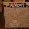 A celebratory sign with hundreds of signatures urging the retention of the Hawleyville Post Office in that area of town was on display at Thursday evening's gathering. The USPS decision to relocate and not close the troubled Route 25 facility is an example of the power of the collective voice, said speakers.  (Crevier photo)