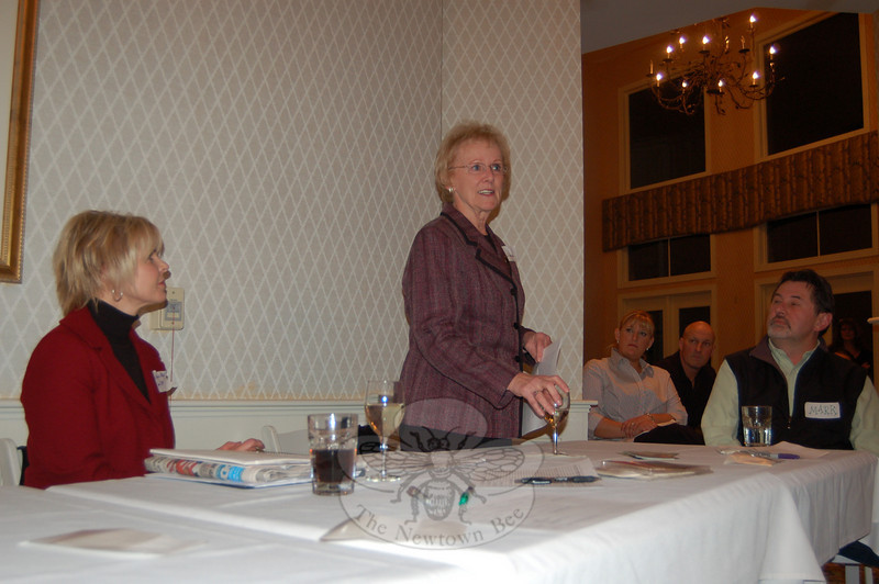 Newtown First Selectman Pat Llodra addressed residents and business owners of Hawleyville and Stony Hill at an organizational meeting on February 18 that promoted the collaboration between the two business areas.  Looking on are Save Hawleyville Post Office and HEAT organizer Ann Marie Mitchell (left) and Hawleyville Postmaster Mark Favale. UK Gourmet owners Lisa and Nigel Whitmore are in the background.  (Crevier photo)