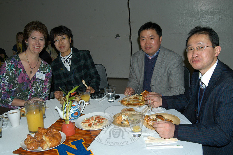 Board of Education Chair Lillian Bittman sits with members of the delegation from Liaocheng Middle School Number 3, Shandong Province, China, during the welcoming breakfast at NHS on Thursday, February 18.  (Hallabeck photo)