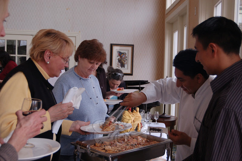 Pat Schecora and Pedja Myslik were among those who enjoyed the offerings during a tasting event on March 4 at The Homesteads of Newtown. Here they were being served some of the Chicken a la Milano that had been whipped up by the staff of Tuscany.  (Crevier photo)