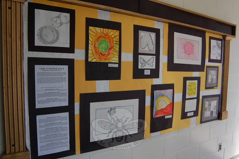 """Students across the school district were asked to """"Take a Closer Look"""" for a collaborative art project that is now hanging in the schools after Sandy Hook School art teacher Leslie Gunn visited Santa Fe, N.M., last summer. This is part of the selection of work on view at Middle Gate School.  (Hallabeck photo)"""