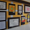 "Students across the school district were asked to ""Take a Closer Look"" for a collaborative art project that is now hanging in the schools after Sandy Hook School art teacher Leslie Gunn visited Santa Fe, N.M., last summer. This is part of the selection of work on view at Middle Gate School.  (Hallabeck photo)"