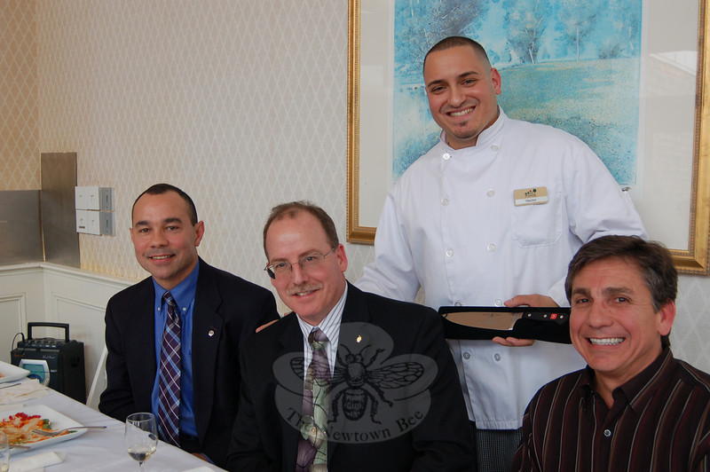 Tasting Competition winner Chef Hector Velez of The Homesteads was all smiles following his win on March 4. Seated from left are judges Capt Joe Rios, Scott Senette, and Paulo Azevedo.  (Crevier photo)