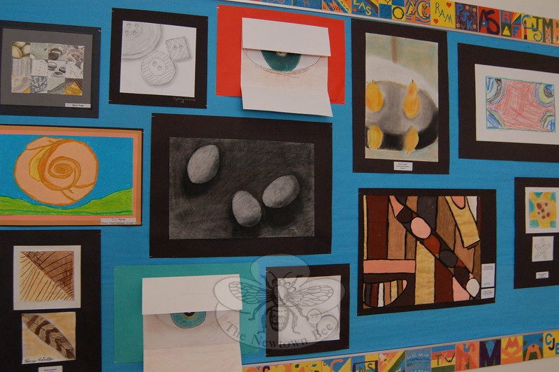 "Students across the school district were asked to ""Take a Closer Look"" for a collaborative art project that is now hanging in the schools after Sandy Hook School art teacher Leslie Gunn visited Santa Fe, N.M., last summer. This is part of the selection of work on view at Reed Intermediate School.  (Hallabeck photo)"