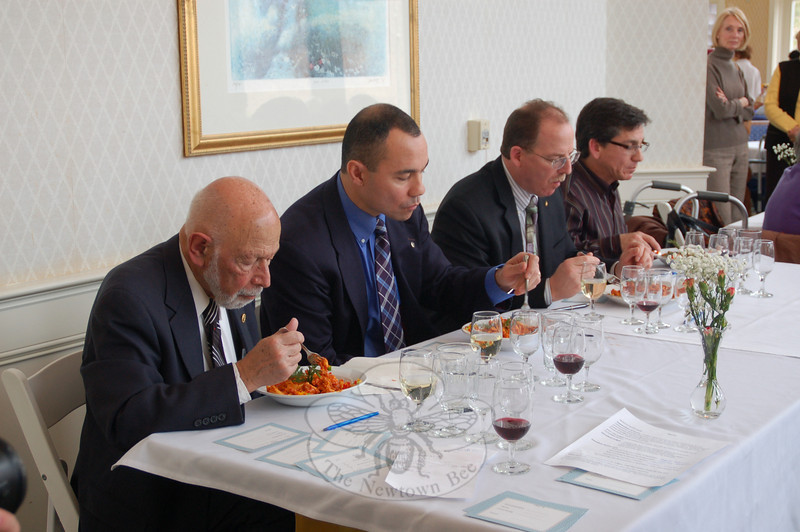 From left, judges Dr Robert Grossman, NPD Captain Joe Rios, Union Savings Bank vice president Scott Senette, and veterans benefits counselor Paulo Azevedo sample the entry from Sal e Pepe Restaurant in Newtown.  (Crevier photo)