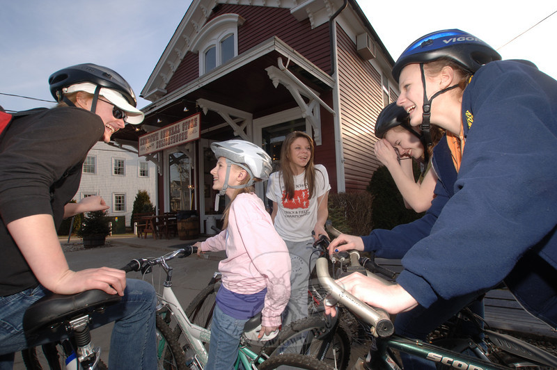 Wednesday afternoon's warm weather prompted a group of sisters and friends to ride their bikes to Newtown General Store where they propped them up and went inside for a snack. Shown here are, from left, Danielle Chaloux, Abbi Winters, Lydia Beiter, Morgan Winters, and Nicole Chaloux. The next stop on their tour through the center of town was C.H. Booth Library.  (Bobowick photo)