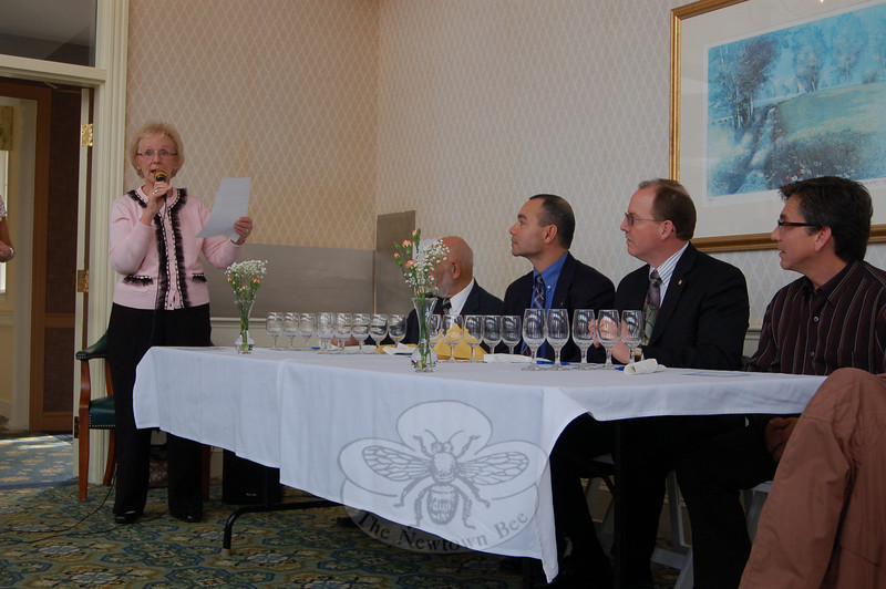 Newtown First Selectman and host for the Annual Homesteads Tasting Competition Pat Llodra, left, goes over the contest rules as judges Dr Robert Grossman, Capt Joe Rios, Scott Senette, and Paulo Azevedo look on.  (Crevier photo)