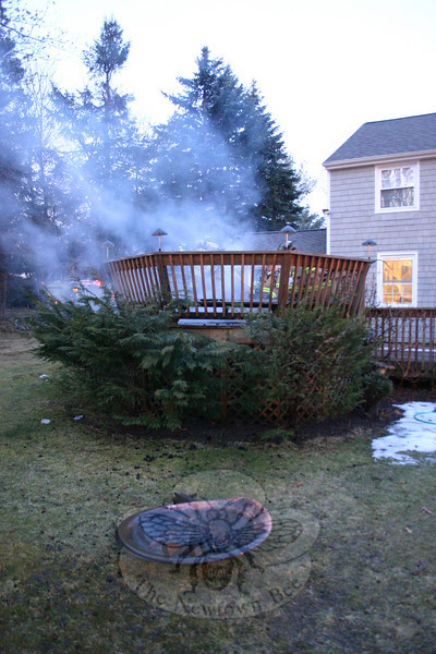 Firefighters responded about 5:45 am March 8 to a fire on a wooden deck at a Toddy Hill Road home in Sandy Hook, which resulted in an estimated $5,000 worth of property damage. The accidental blaze was caused by the presence of a metallic fire bowl, shown in the foreground, which had been in use on the deck the previous night.  (Hicks photo)