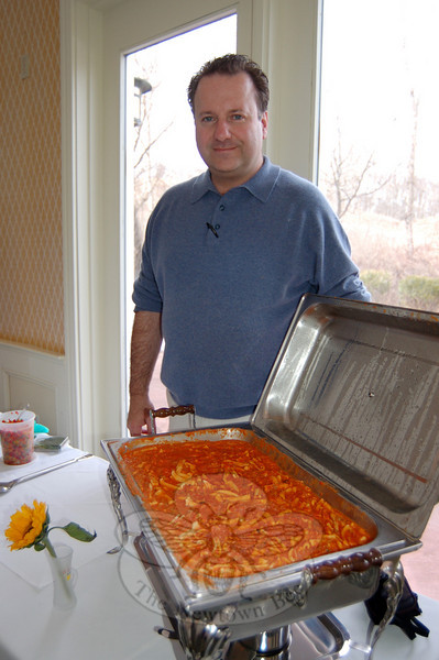 Angelo Marini, the owner of Sal e Pepe Restaurant on South Main Street, displays his dish of homemade ricotta cavatelli in a San Marzano peeled tomato sauce, with chicken apple sausage, cream and coriander. Mr Marini paired the pasta with a 2008 Corvo Insolia wine from Sicily.  (Crevier photo)