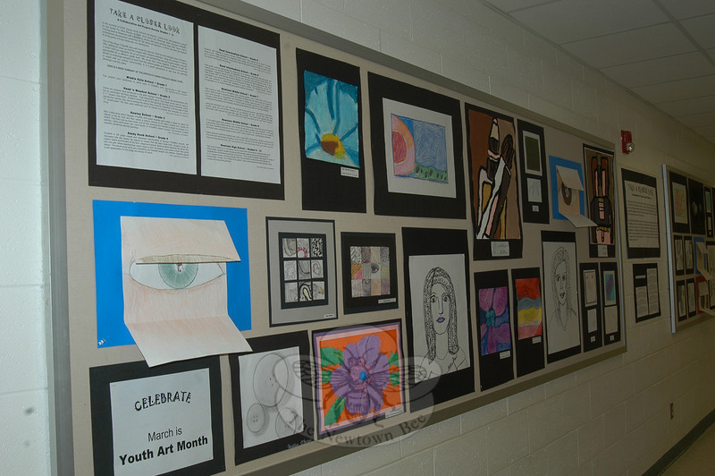 "Students across the district were asked to ""Take a Closer Look"" for a collaborative art project that is now hanging in the schools after Sandy Hook School art teacher Leslie Gunn visited Santa Fe, N.M., last summer. This is part of the presentation at Hawley School.  (Hallabeck photo)"