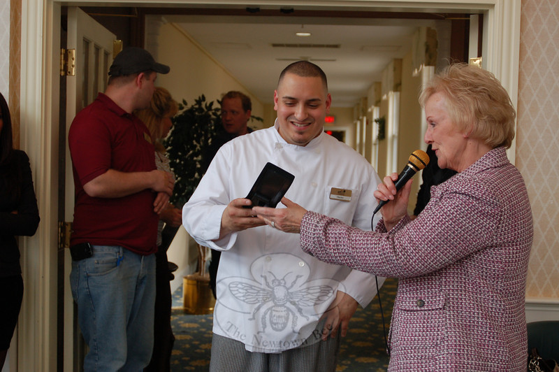 """It's great, I'm happy,"" said Chef Hector Velez, accepting his prize of an engraved Wusthof chef's knife from First Selectman Pat Llodra following a tasting competition at The Homesteads on March 4.  (Crevier photo)"