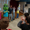 Chartwells School Dining Services resident dietician Jill Patterson, left, taught Head O' Meadow students the principles of a balanced diet and exercise during an Eat, Learn, Live Assembly on Monday, March 1, with help from Newtown High School students George Primavera (middle) and Chris House. NHS students Caitlin Anderson and Rachel Mrozinski dressed as a bunny and turtle, respectively, both characters created by Chartwells.  (Hallabeck photo)