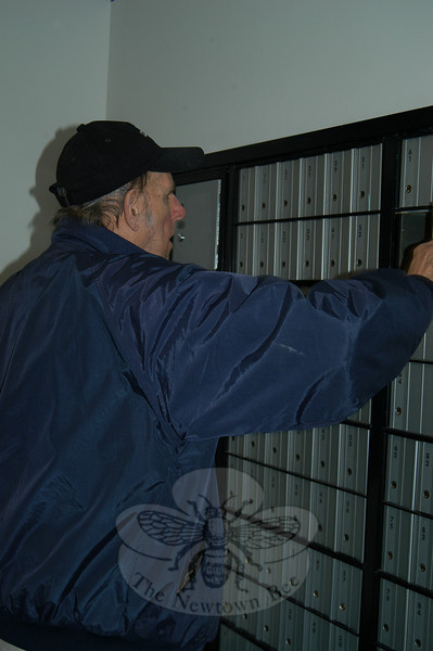 Ed Beers, a 48-year patron of the Hawleyville Post Office, used his new key to open his post office box at the Hawleyville Post Office facility on Monday morning, March 15.  (Crevier photo)