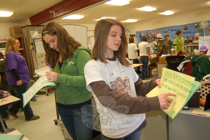Members of the Jamaican team in the Newtown Middle School Cluster 8 Blue Survivor Grammar Olympics Ellen Atkinson, right, and Siena Chicarelli, asked other teams questions on wordiness on Friday, March 5.  (Hallabeck photo)
