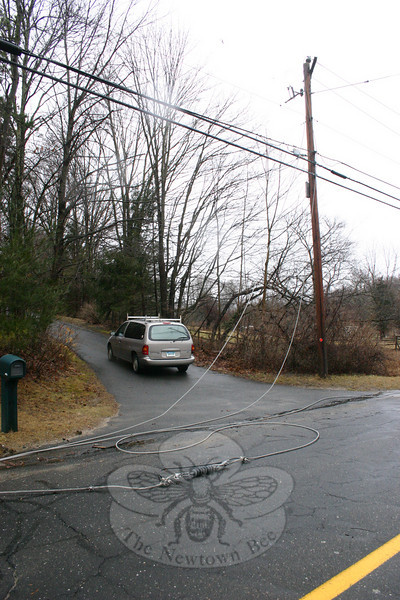 One homeowner along Toddy Hill Road was unable to leave their home on Sunday until after CL&P arrived to clear a number of wires that had been taken down during the Saturday-Sunday overnight. Heavy winds and rains caused damage to many poles and wires in town. (Hicks photo)