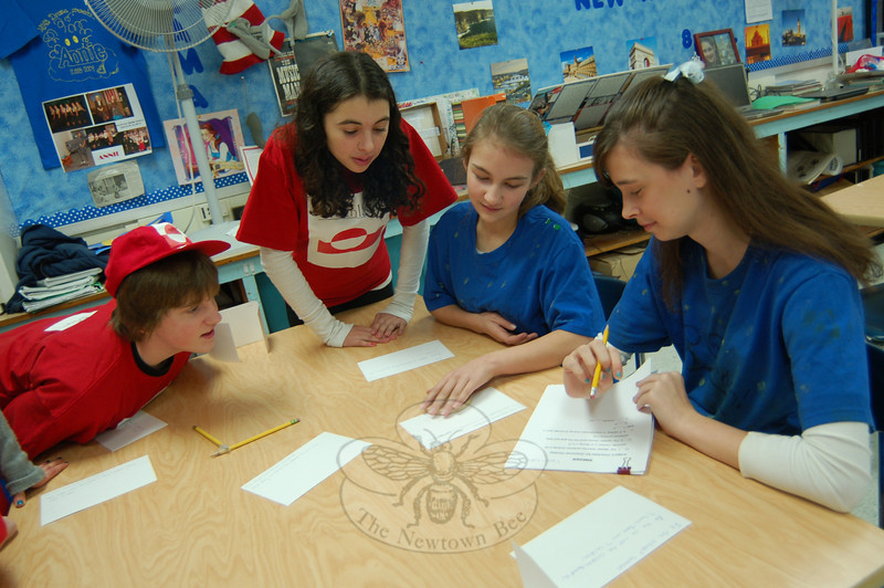 From left, members of the Greenland team, Matt White and Charlotte Gray, played a game prepared by their fellow Cluster 8 Blue students on the Sweden team during the first Survivor Grammar Olympic challenge in the cluster. Sweden members Joy Sgobbo and Suzanne Kerler, right, oversaw the game their team created being played.  (Hallabeck photo)