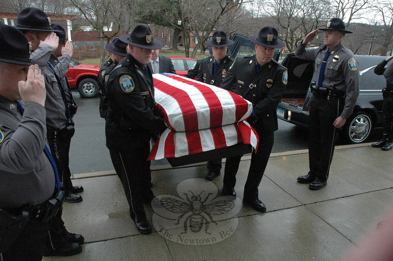 Six Newtown police officers served as pallbearers on the morning on Monday, March 15, during funeral services for James Louis Comerford, Jr, 77, of Sandy Hook, who was a special police officer for the Newtown Police Department. Mr Comerford's flag-draped casket is seen being carried into St Rose of Lima Church for the funeral. Serving as pallbearers were Lieutenant James Mooney, Sergeant Douglas Wisentaner, Detective Joseph Joudy, Detective Jason Frank, Patrol Officer Robert Haas, and Patrol Officer Richard Monckton.  (Gorosko photo)