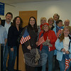 From left, Hawleyville Post Office staff member Rich Ruscitto, Postmaster Mark Favale, and staff member Laura Smolen pose with patrons and supporters of the post office. Front from left are Stephanie Podewell from Congressman Chris Murphy's office, former Newtown state representative Mae Schmidle, Sylvia Malinski, and Renee Baade. Back row, Ann Marie Mitchell, Terry Laslo, Lilla Dean, Tom Dwyer, and Dot Dwyer.  (Crevier photo)
