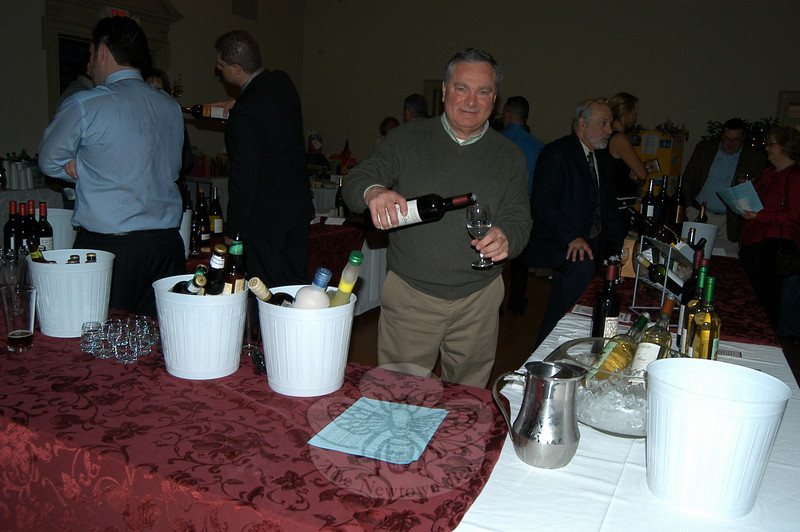 Jim Ferrara of Puglia Wines, a Waterbury-based importer and distributor of fine wines and cordials from around the world, poured Italian wine on Saturday, March 13, in the Alexandria Room of Edmond Town Hall for the Third Annual International Food & Wine Tasting presented by Trinity Church. Proceeds from the event benefit youth pilgrimage and Haiti earthquake relief. For $25 eventgoers could taste a selection of international wines and food, and participate in a silent auction and a cash for gold program from Becker's Jewelry.  (Hallabeck photo)