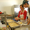 A home school co-op uses the kitchen and gathering room at Newtown Congregational Church once each week. The week The Bee caught up with the group they were preparing lunch for the 90 people in the program that uses the facilities each Tuesday.  (Hallabeck photo)
