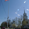Where else is there a flagpole in the middle of Main Street, wonders Sue Capozziello Marcinek, that charming feature that makes Newtown her hometown.  (Bee file photo)