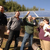 Resident Peter Alagna raises a toast as his new solar panels, behind him, that began to gather and generate power for his Head of Meadow home this month. He and his wife Rosalia, right, celebrate with Trinity Solar installer Mike Mazzamurro, far left, and consultant Bill Nastri.  (Bobowick photo)