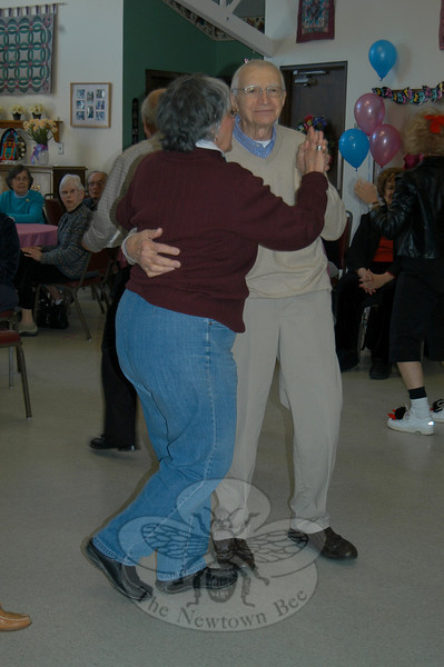 Rolled-up jeans, hair bows for women, and high spirits for all was the order of the day at the Newtown Senior Center on March 24,when the band At The Hop got seniors rockin' and rollin' to tunes of the 50s and 60s. Among those enjoying the music were Nick and Nancy Constantino, who took to the floor for some dancing.  (Crevier photo)