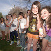 Gripping soft serve cones and cold drinks are Newtown Middle School students, from right, Tess Stofko, Kayla Murphy, Kyle Robertson with the cone to his lips, Jon Sherman, Alexa Summerlin, and leaning together are Karly Gregorio and Bailey Solomons. These classmates and friends filled the benches and gathered in lines with other residents Wednesday to buy a cold treat as the temperature reached nearly 80 degrees.  (Bobowick photo)
