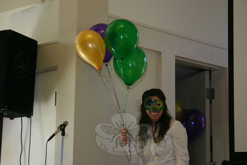 Campers began the morning's entertainment segment by entering the hall wearing Mardi Gras masks and carrying balloons.  (Hicks photo)
