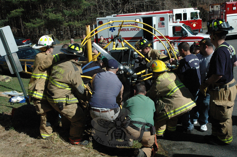 Emergency services workers joined forces at Fairfield Hills on the morning of Good Friday, April 2, to free a Waterbury woman who was trapped in accident wreckage, after the powered parachute aircraft that she was taxiing down a paved slope collided with a metal gate near the turnaround circle at Keating Farms Avenue.  (Gorosko photo)
