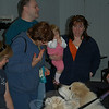 From left, Beth Britton, Joni Spielberg and the Douglas Family, Matt, Michelle, and baby Grace greet Great Pyrenees Hudson and Murphy at a meet and greet at the C.H. Booth Library Sunday afternoon, March 21, to support the 2 Dogs, 2000 Miles walk.  (Crevier photo)