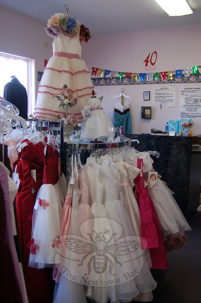 Flower girls can be outfitted with flair at Julie Allen Bridals in any of a number of fancy dresses that the shop stocks.  (Crevier photo)
