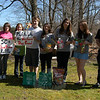 Members of Newtown High School's Vegetarian and Animal Concerns Club brought treats and items to the Newtown Dog Pound the club bought through funds raised during a St Valentine's Day raffle. Animal Control Officer Carolee Mason, left, and dog pound kennel attendant Matt Schaub, right, stand with the students on Thursday, April 1, when the club had a tour of the dog pound.  (Hallabeck photo)