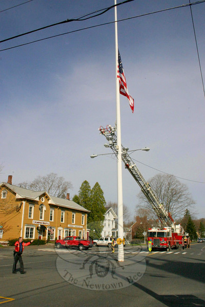 Newtown Hook & Ladder lowered the flag on Newtown's flagpole at 9:30 on April 5 in honor Marine Lance Corporal Tyler Griffin, 19, of Voluntown, who was killed recently while on active duty in Afghanistan.  (Hicks photo)